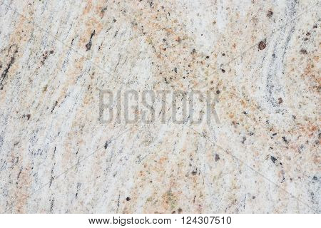 Beige granite texture with natural pattern. Granite stone wall background.