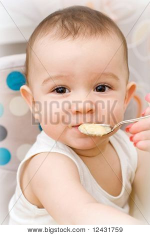 Cute Caucasian Baby Eating