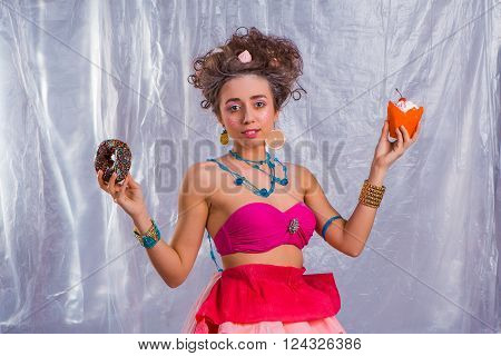 Beautiful  Girl With Colorful Donut And Muffin