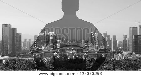 silhouette of a man superimposed on a panorama view of a modern city black and white.