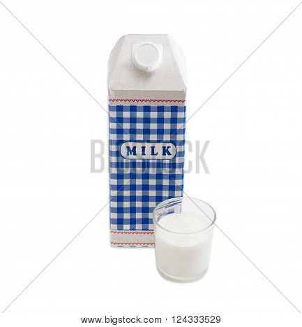 Plastic coated paper carton with pasteurized cows milk and a glass of milk on a light background