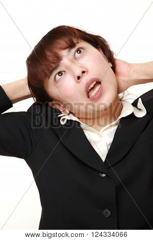 portrait of demented businesswoman on white background