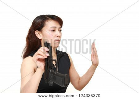 surrendered Asian woman with a hand gun