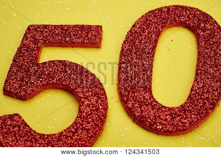 Number fifty red color over a yellow background. Anniversary. Horizontal