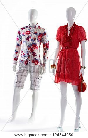 Dress and shirt on mannequins. Mannequins in bright summer clothing. Men's shirt and woman's dress. V-neck dress and floral shirt.