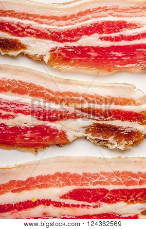 Streaky bacon on the white background vertical