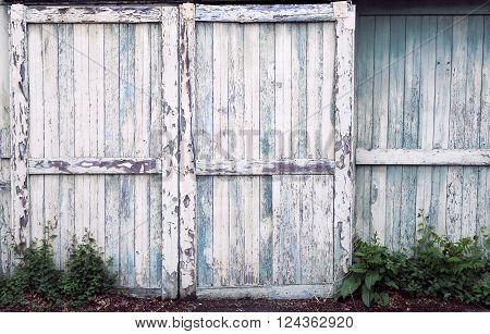 Sliding doors on an old barn with peeling paint