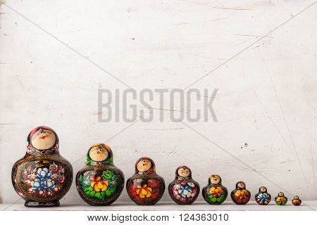 Matreshka set on the white scratched background