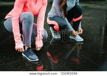 Women Ready For Running  And Training Under The Rain