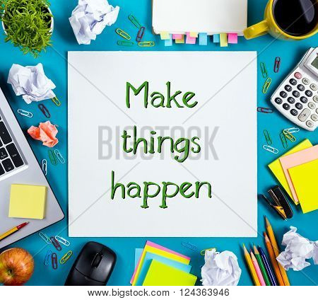 Make things happen. Office table with notepad, computer and coffee cup on blue background. Business creative consept top view