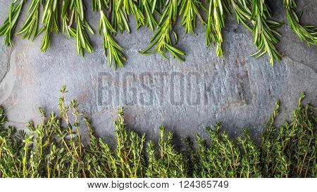 Thyme and rosemary sprigs on the stone table