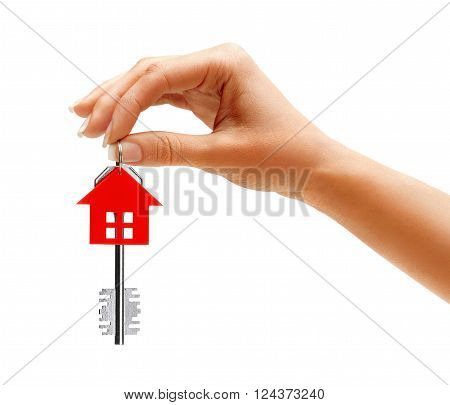 Woman's hand holding key to the apartment isolated on white background
