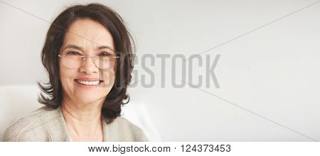 Close Up Portrait Of A Senior Attractive Middle-aged Brunette Woman With A Beautiful Smile Relaxing
