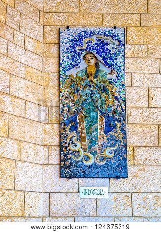 NAZARETH ISRAEL - FEBRUARY 21 2016: The beautiful bas-relief of Madonna was donated by indonesian christians is located in the arcade of the Basilica of Annunciation on February 21 in Nazareth.