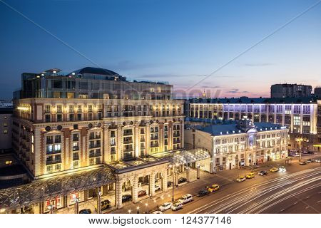 MOSCOW - JULY 1, 2014: (long exposure) Tverskaya street (main street) of Moscow. Ritz-Carlton hotel at evening