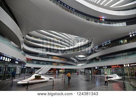 BEIJING CHINA - NOV 20 2015: SOHO Galaxy office building architect Zaha Hadid.