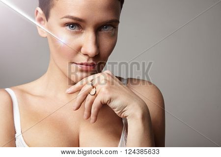 Woman With Ideal Skin With A Rey Of Laser On A Face. Spf Protection Concept. Laser Cosmetology