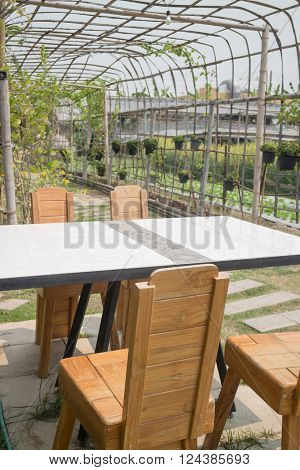 Outdoor dinner table in the garden stock photo
