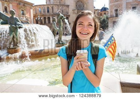 Young student smiling happy and drinking coffee in Valencia Spain. Travel and tourism concept.