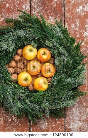 Christmas advent wreath filled with apples and nuts