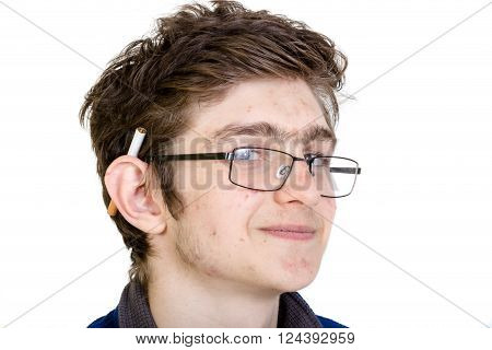 Teen boy with a cigarette behind his ear
