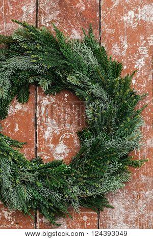 Handmade Christmas advent wreath on wooden table