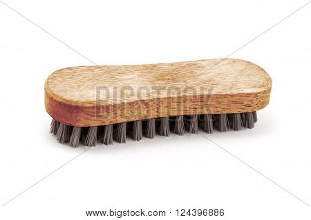 Wooden shoe brush isolated on a white background.