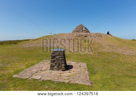 DUNKERY BEACON, SOMERSET, ENGLAND-JULY  10TH  2015: Walkers enjoying a rest in the beautiful summer weather having climbed to the top of Dunkery Hill, Somerset on Friday 10th July 2015