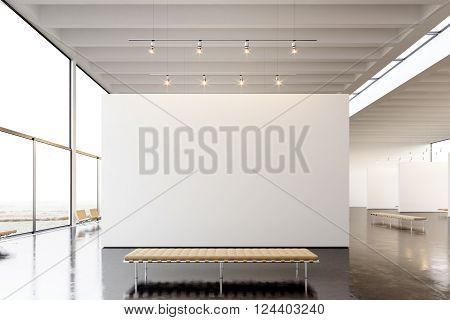 Picture exposition modern gallery, open space.Blank white empty canvas hanging contemporary art museum. Interior loft style with concrete floor, light spots and generic design furniture.