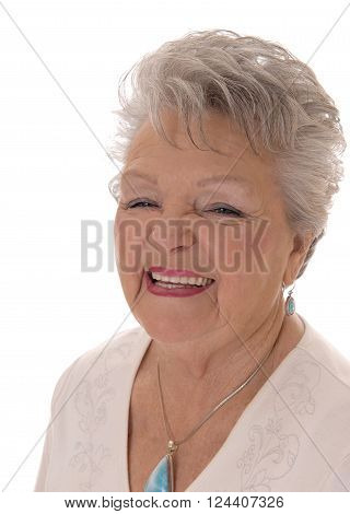 A closeup image of a smiling senior citizen woman in her seventies with short grey hair isolated for white background.