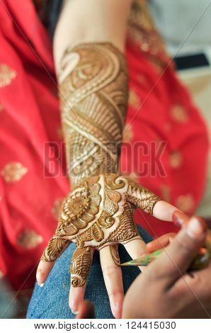 Bride gets done Mehandi design on her full hand ** Note: Visible grain at 100%, best at smaller sizes