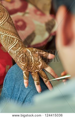 Bride gets Mehandi Tattoo on her hand by Mehndi artist ** Note: Visible grain at 100%, best at smaller sizes