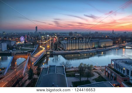 WROCLAW POLAND - APRIL 02 2016: Aerial view of Wroclaw. Illuminated city skyline during a beautiful sunset April 02 2016 in Wroclaw Poland.