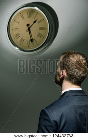 Young Man And Ticking Clock