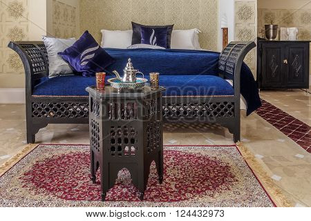 Luxury moroccan room suite with tea service and couch