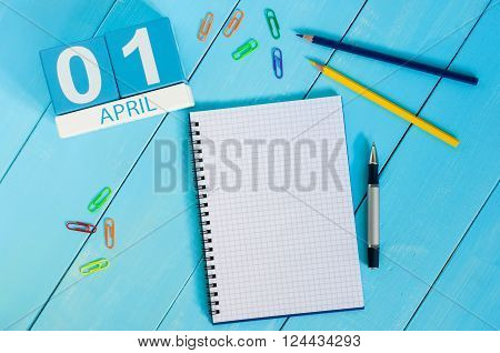 April 1st. Image of april 1 wooden color calendar on blue background.  Spring day, empty space for text. All Fool's Day.