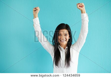 Happy Girl With Hands Over Head Standing Over Blue Background