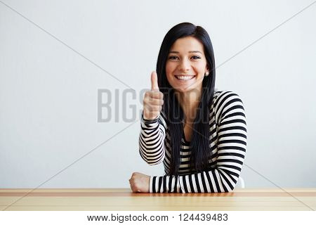 Happy Beautiful Woman Makes The Gesture With Thumb Up