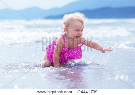 Little Cute Happy Girl Bathes In Sea,  Italy, Outdoor