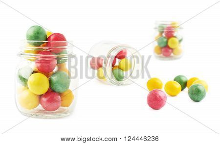 Chewing gum balls and glass jar composition, isolated over the white background