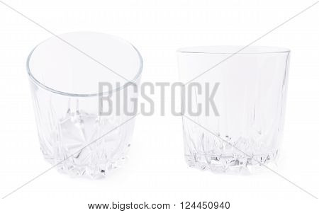 Empty whiskey tumbler glass isolated over the white background, set of two foreshortening images