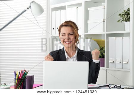 Portrait Of Happy Businesswoman Celebrating Something With Arms Up