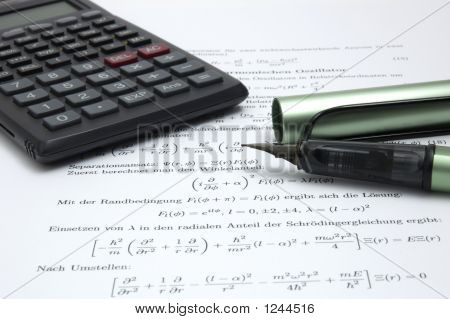 Calculator And Pen On Scientific Paper