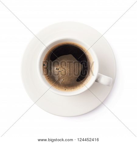 Fresh cup of black coffee on a white ceramic plate, composition isolated over the white background, top view above foreshortening