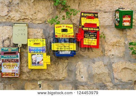 JERUSALEM ISRAEL - FEBRUARY 25 2016: Jewish charity donation boxes on the wall in the ultra-orthodox neighborhood Mea Shearim Jerusalem Israel