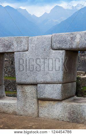 a polygonal stone wall in Machu Picchu