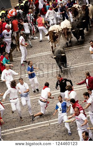 Spain Navarra Pamplona 10 July 2015 S Firmino fiesta men run from bulls in street Estafeta the bulls will go toward the plaza de toro for the afternoon bullfight