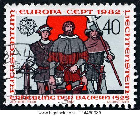 LIECHTENSTEIN - CIRCA 1982: a stamp printed in the Liechtenstein dedicated to Peasants' Uprising, 1525, circa 1982