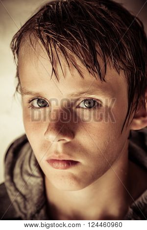 Thoughtful Solemn Young Boy With Wet Hair