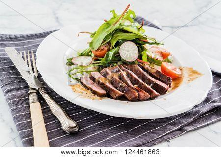 steak with salad